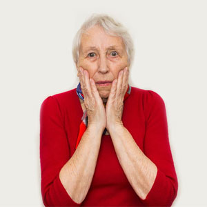 Worried senior woman concerned about her health when living alone